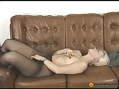 Through pantyhose touching her pussy