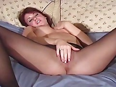 Vixen widens legs in pantyhose to expose vagina