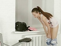 Slim Teen Puts On Workout Clothes In Gym