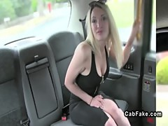 Busty banged from behind in a fake taxi