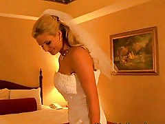 Blonde bride sucks cock down on her knees in white gown