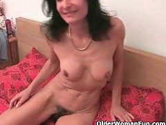 Grandma Emanuelle masturbates and gets fingered by the photographer
